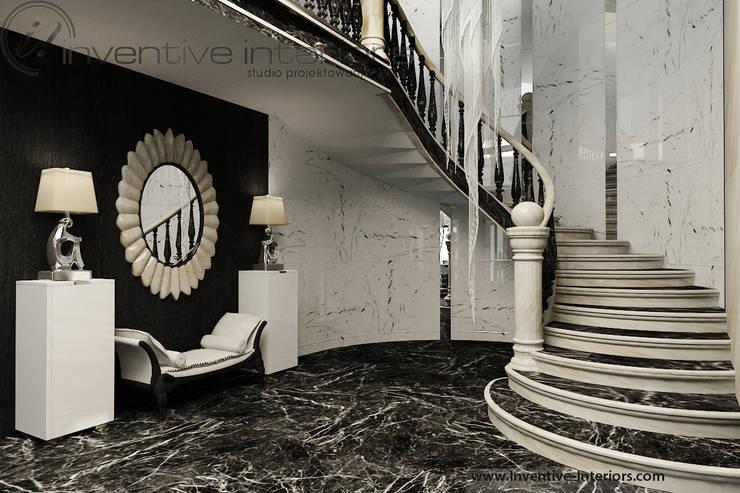 Pasillos, vestíbulos y escaleras de estilo clásico de Inventive Interiors Clásico Mármol