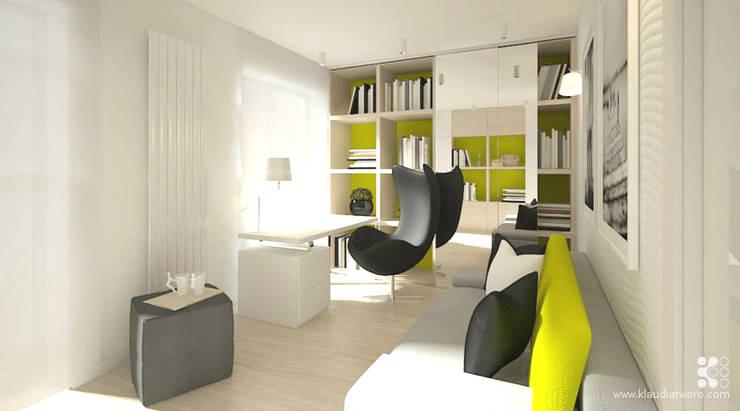 DOM W SELEDYNACH: styl , w kategorii Domowe biuro i gabinet zaprojektowany przez Klaudia Tworo Projektowanie Wnętrz Sp. z o.o.,