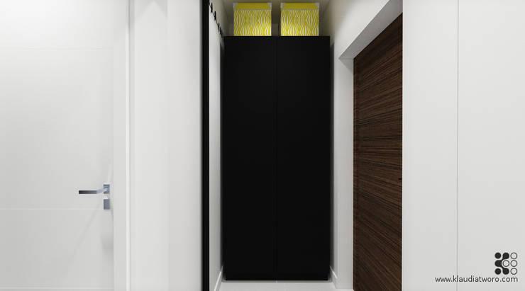 31m2 DLA KAWALERA: styl , w kategorii Korytarz, przedpokój zaprojektowany przez Klaudia Tworo Projektowanie Wnętrz Sp. z o.o.