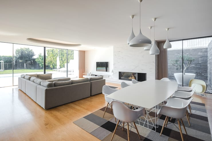Comedores de estilo minimalista por Raulino Silva Arquitecto Unip. Lda