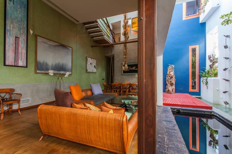 Salas / recibidores de estilo  por Pablo Cousinou