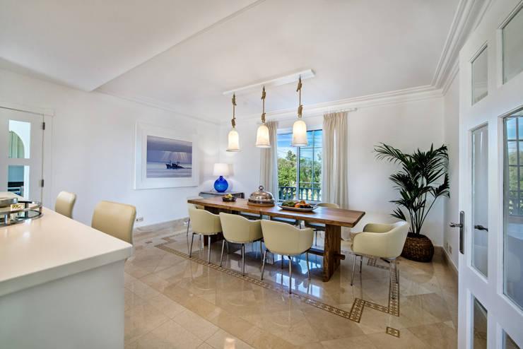 Sala de jantar  por Interdesign Interiores