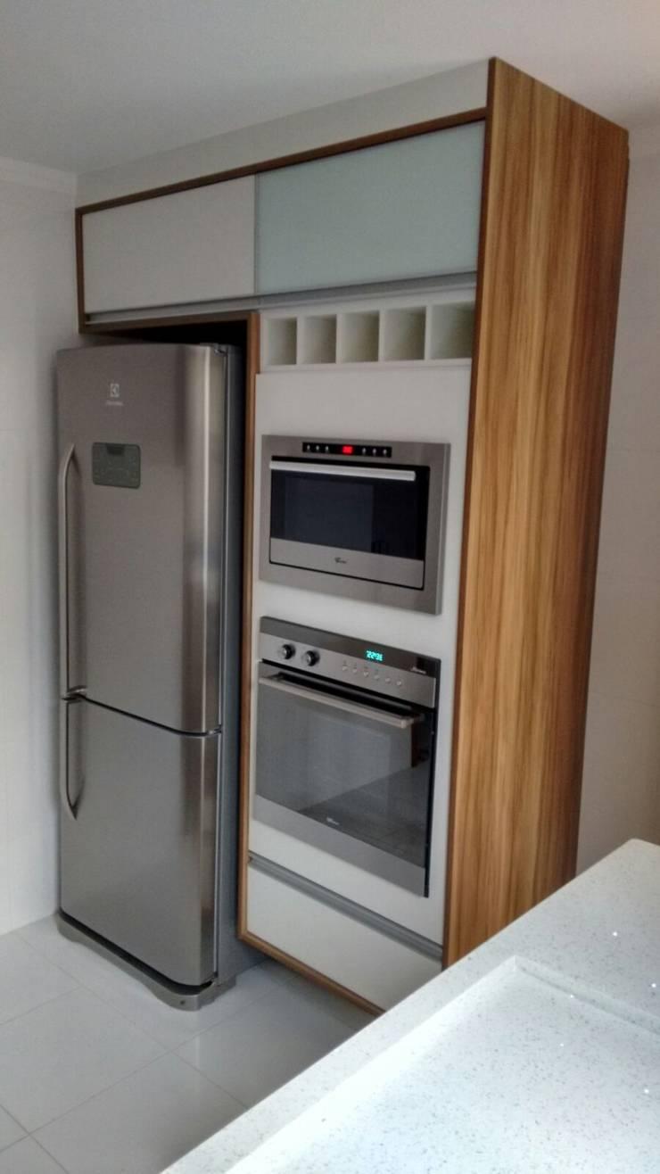 Cozinha: Cozinhas  por Total Planejados,Moderno MDF