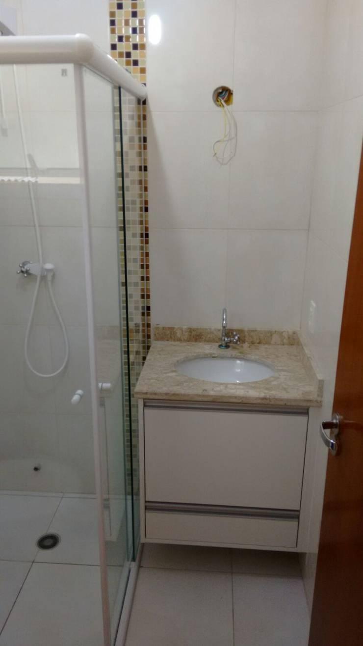 Banheiro: Banheiros  por Total Planejados,Clássico MDF