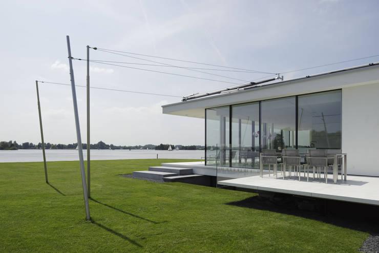 Zijgevel:  Huizen door Lab32 architecten, Modern