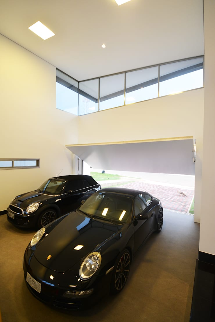 Casa AE: Garagens e edículas  por Arquitetura 1