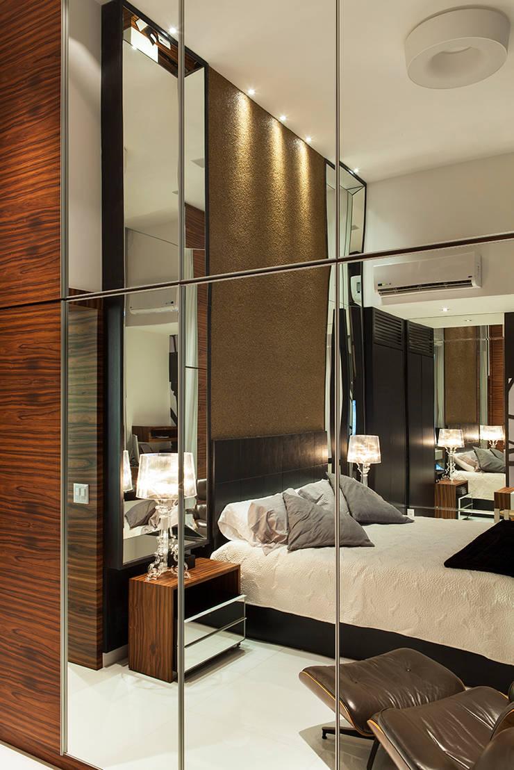 Suite do Casal AQVA: Quartos  por daniela andrade arquitetura,Moderno