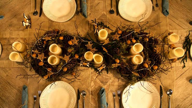 Vistiendo la mesa para Navidad.:  de estilo  por MARIANGEL COGHLAN