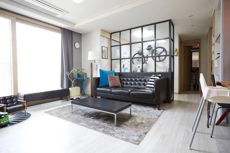 Salas / recibidores de estilo  por DESIGNSTUDIO LIM_디자인스튜디오 림