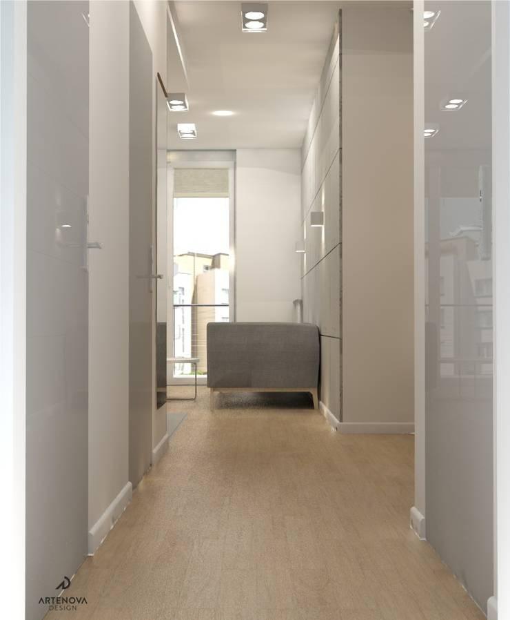 Minimalistyczne mieszkanie w Warszawie: styl , w kategorii Korytarz, przedpokój zaprojektowany przez Artenova Design