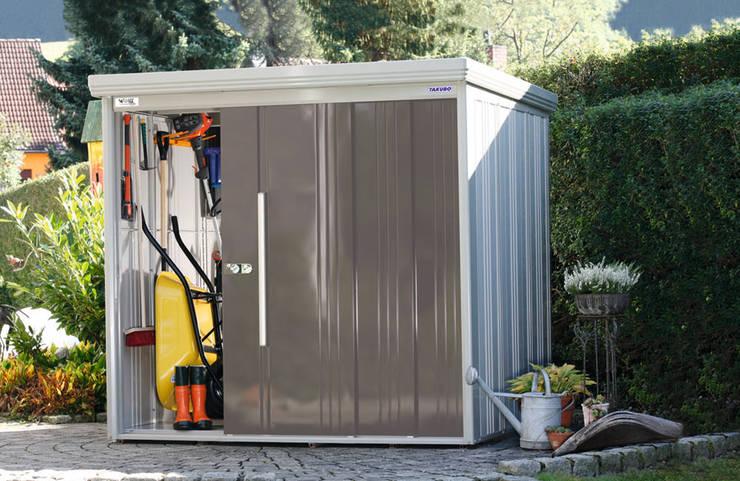 Garajes de estilo  por Gartenhaus2000 GmbH