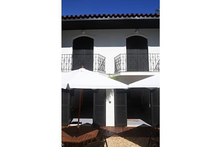 HOSTEL VILA MADALENA: Casas  por Tria Arquitetura