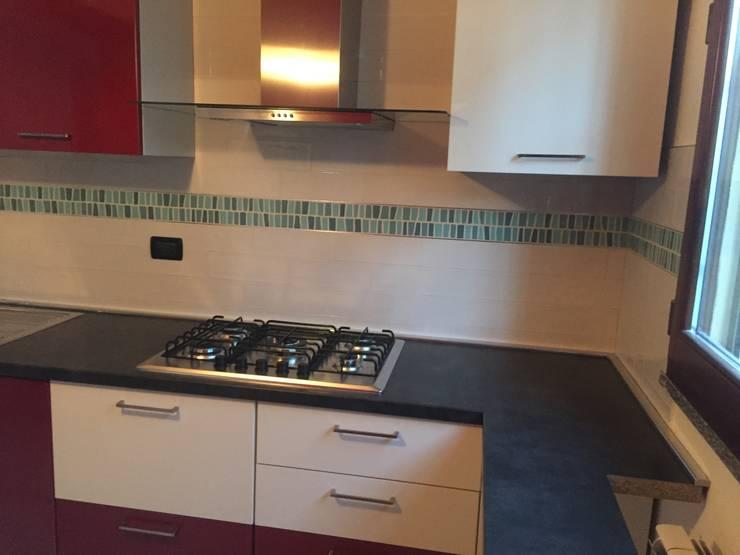 Zona cottura: Cucina in stile  di Arreda Progetta di Alice Bambini,