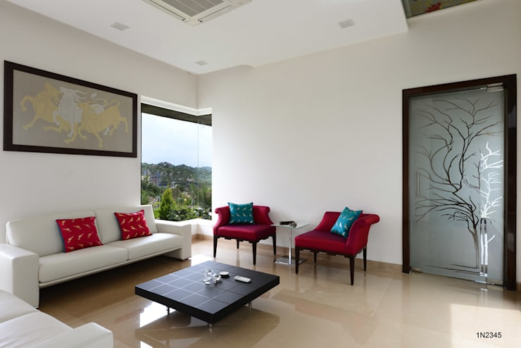 Residential Bungalow:  Living room by NA ARCHITECTS