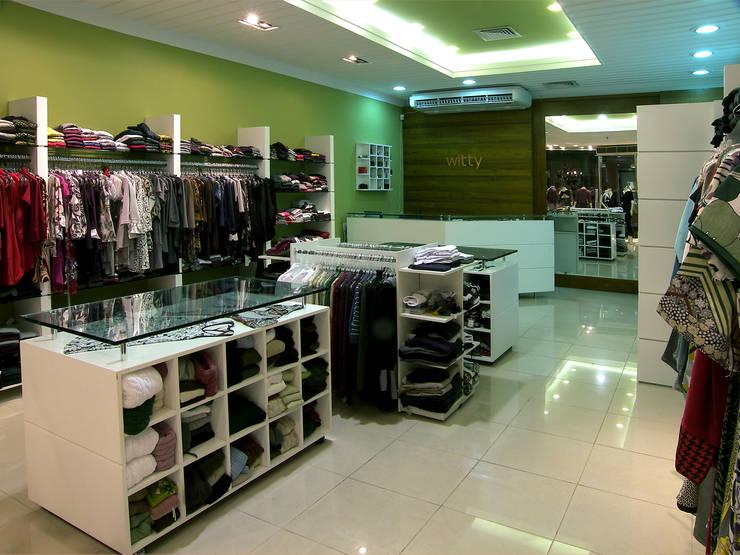 Oficinas y tiendas de estilo  por Luciano Esteves Arquitetura e Design , Moderno