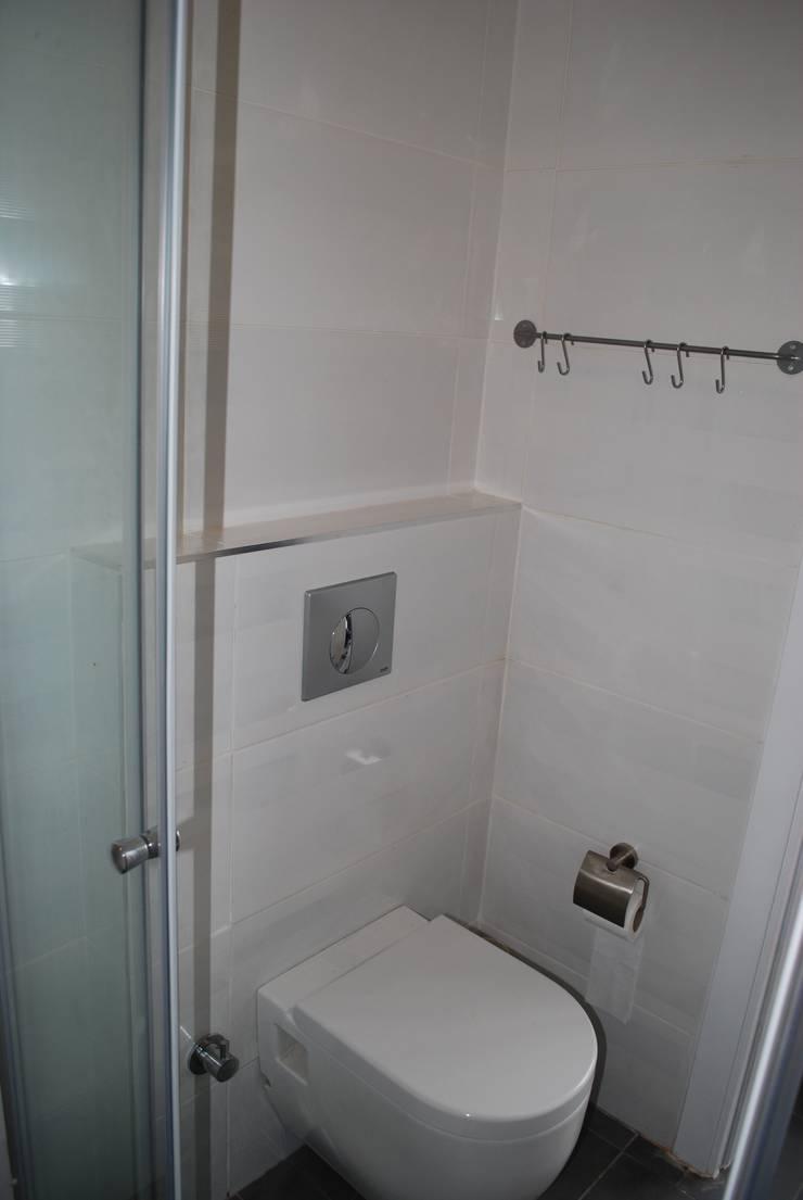 Pil Tasarım Mimarlik + Peyzaj Mimarligi + Ic Mimarlik – WC alanı renovasyon sonrası görünüm:  tarz