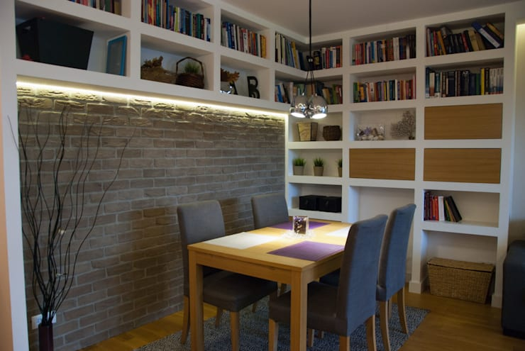 Kącik jadalniany w salonie z biblioteczką: styl , w kategorii Jadalnia zaprojektowany przez ZAWICKA-ID Projektowanie wnętrz