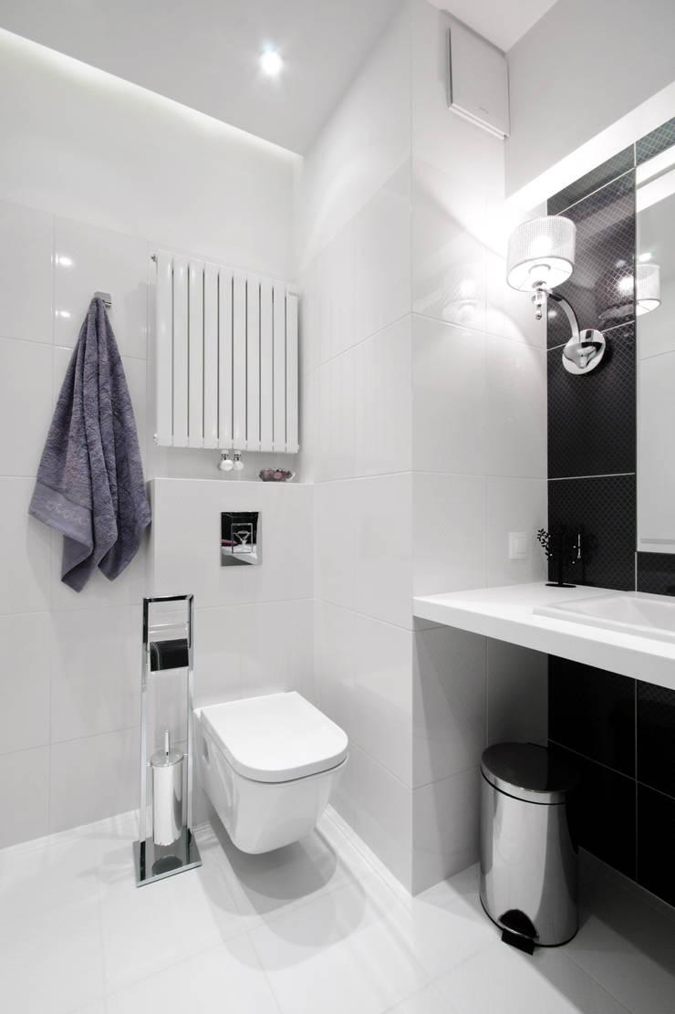 Elegancka łazienka z kobiecymi dodatkami: styl , w kategorii Łazienka zaprojektowany przez ZAWICKA-ID Projektowanie wnętrz,Nowoczesny