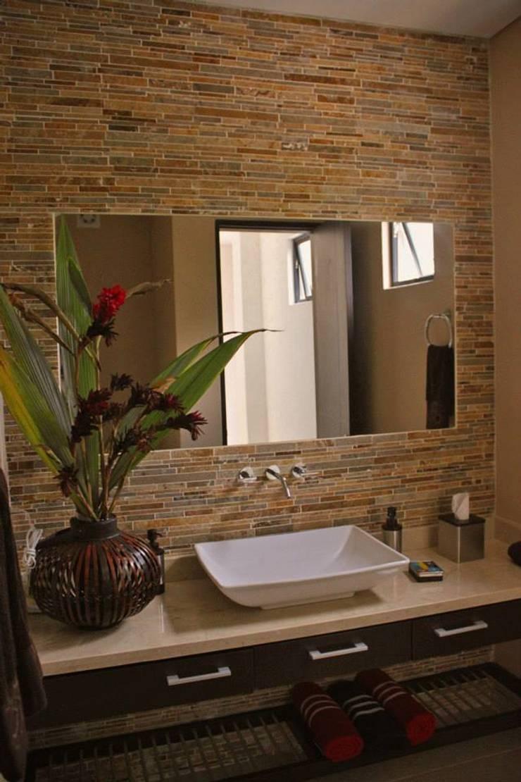 Proyectos Residenciales: Baños de estilo  por MORAND ARQUITECTURA,
