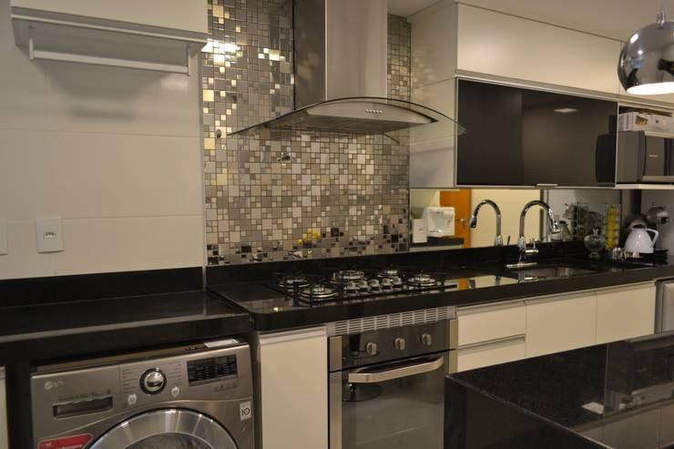 Cozinha Aquarius: Cozinhas  por Isabella Machado Arquitetura
