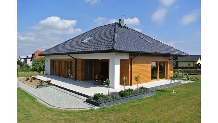 Casas de estilo  por Pracownia Projektowa ARCHIPELAG