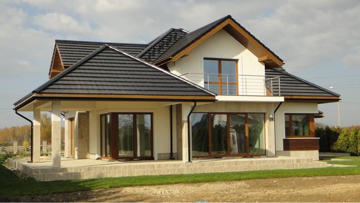 Dom Naomi G2 - stylowa elegancja i luksus przestrzeni we wnętrzu!: styl , w kategorii Domy zaprojektowany przez Pracownia Projektowa ARCHIPELAG