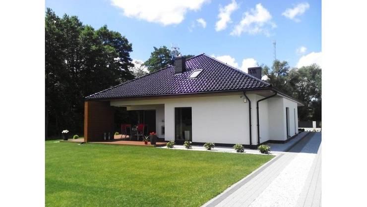 Nowoczesny dom Margaret II G2 - komfort w modnym wydaniu!: styl , w kategorii Domy zaprojektowany przez Pracownia Projektowa ARCHIPELAG