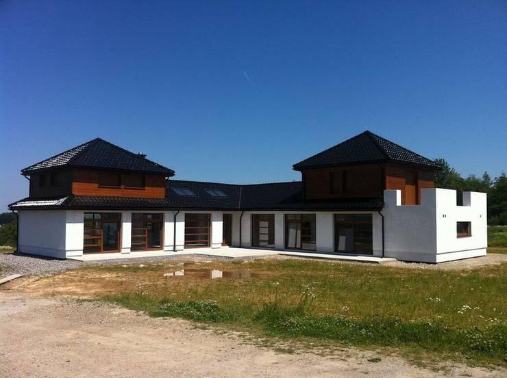 Dom Dionizy (mały) G2 - efektowny, elegancki i bardzo przytulny : styl , w kategorii Domy zaprojektowany przez Pracownia Projektowa ARCHIPELAG,Nowoczesny