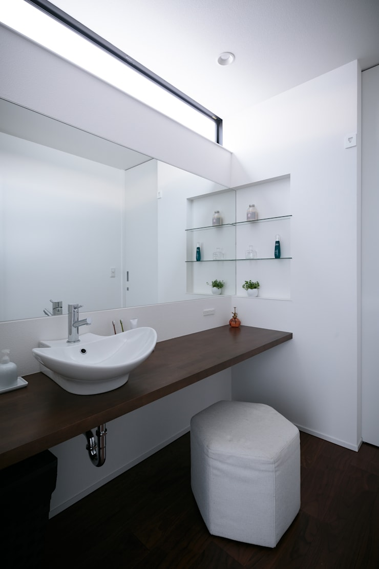 眺望の家: 一級建築士事務所 株式会社KADeLが手掛けた浴室です。