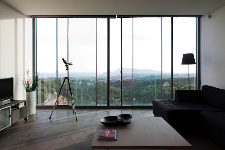 Vivienda Unifamiliar: Salones de estilo  de Eduardo Irago Fotografia
