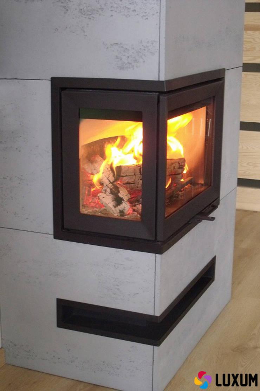 Okładzina kominkowa z betonu architektonicznego: styl , w kategorii Salon zaprojektowany przez Luxum