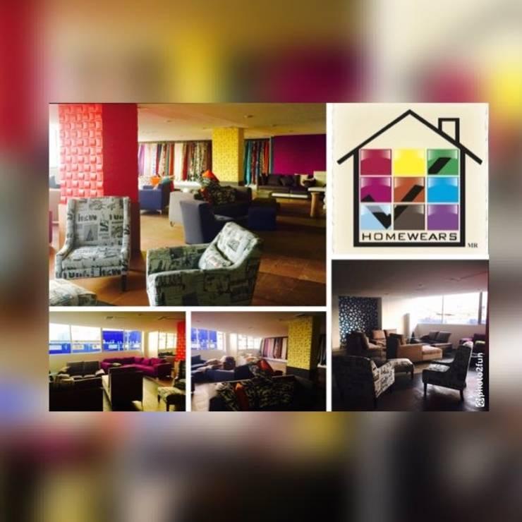NUEVA TIENDA CASA MATRIZ: Paredes y pisos de estilo  por HOMEWEARS S.A. DE C.V.