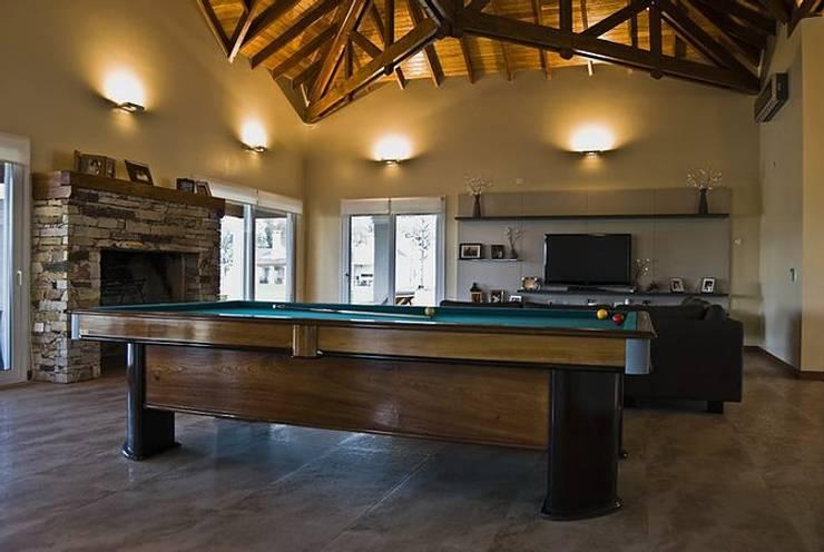 Casa V: Livings de estilo  por Estudio PM
