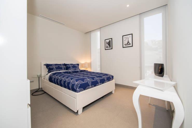 Bedroom by ESTUDIO TANGUMA,