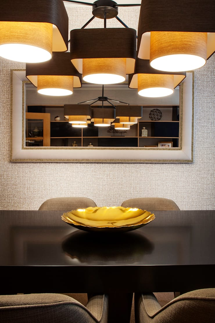 Apartamento Cosmopolita: Salas de jantar  por Spacemakers,Moderno