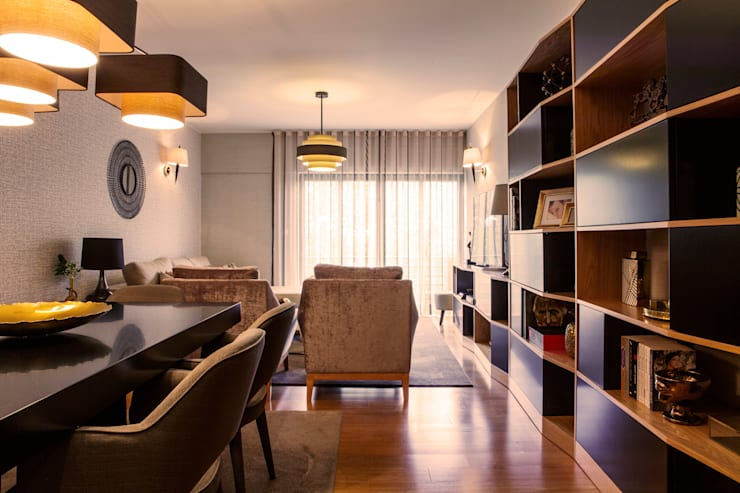 Apartamento Cosmopolita: Salas de estar  por Spacemakers,Moderno