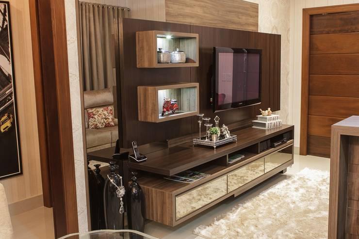 Projeto de arquitetura de interiores residencial.: Salas de estar  por Elaine de Bona Arquitetura e Interiores