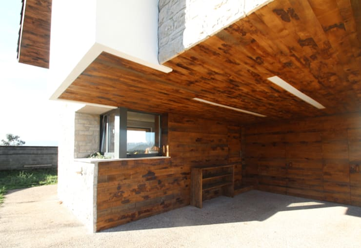 CASA BARBARA: Casas de estilo rústico de R. Borja Alvarez. Arquitecto