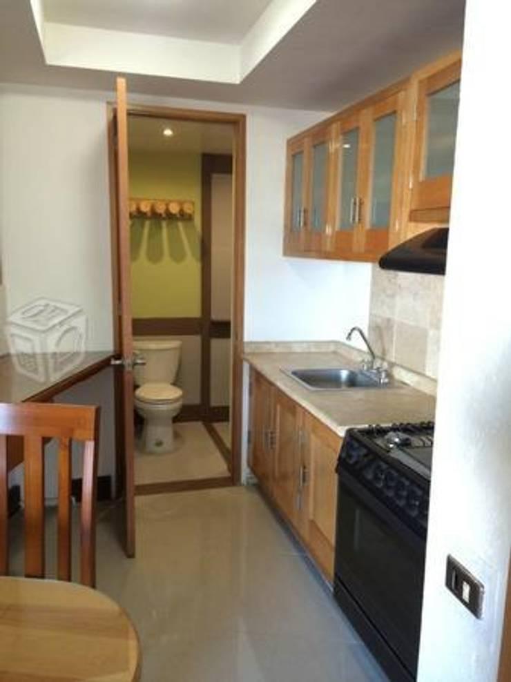 Apartamento: Cocinas de estilo  por Arquitectos Topycon