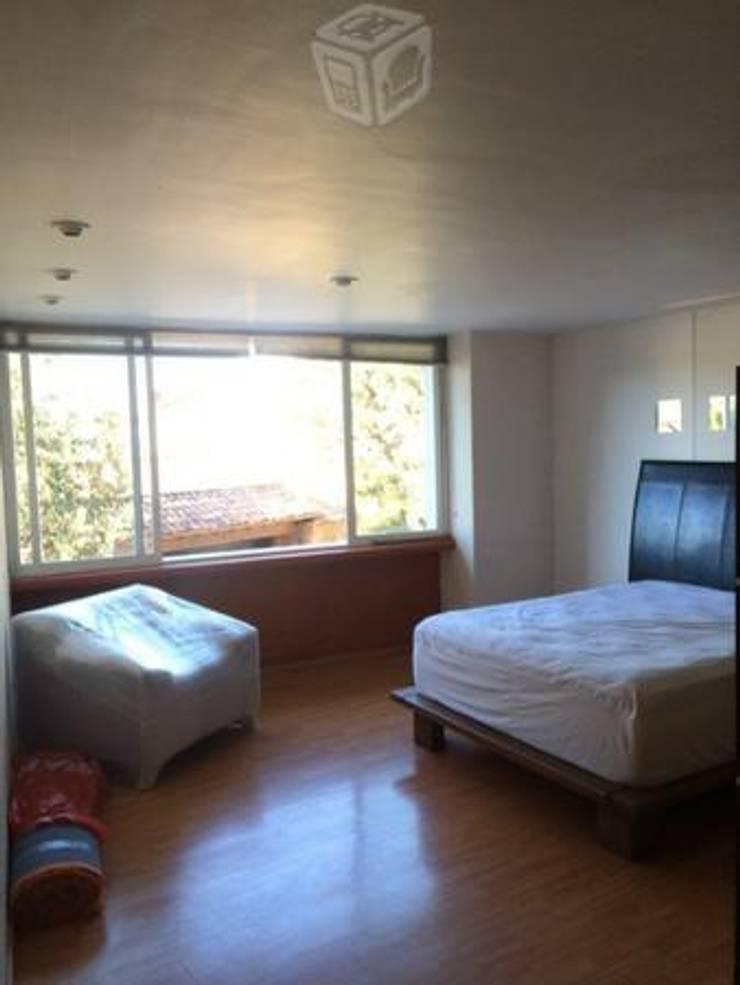 Apartamento: Recámaras de estilo  por Arquitectos Topycon