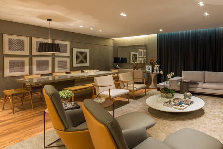 Sala de estar e living: Salas de estar  por Flaviane Pereira