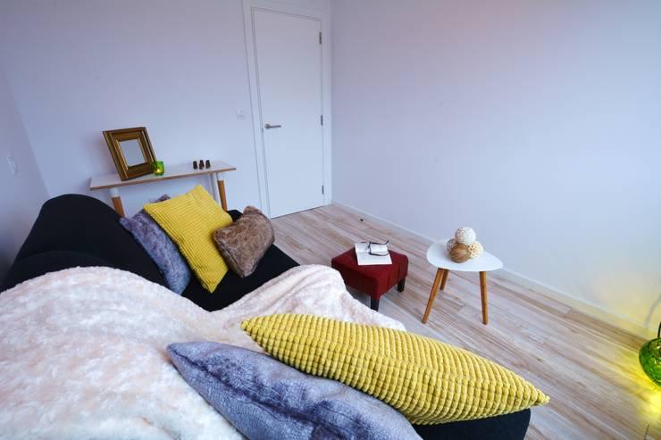 Sala Después:  de estilo  de Ya Home Staging