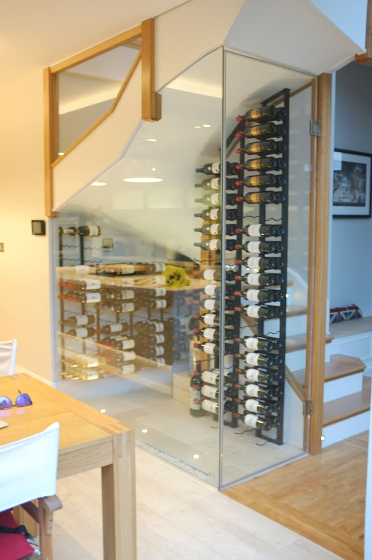 Clapham South—Conversion and Refurbishment:  Wine cellar by Arc 3 Architects & Chartered Surveyors