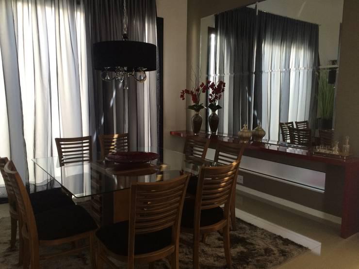 PROJETO DE INTERIORES – RESIDENCIAL LAGO SUL – BAURU / SP: Salas de jantar  por Márcio Cortopassi Arquitetura