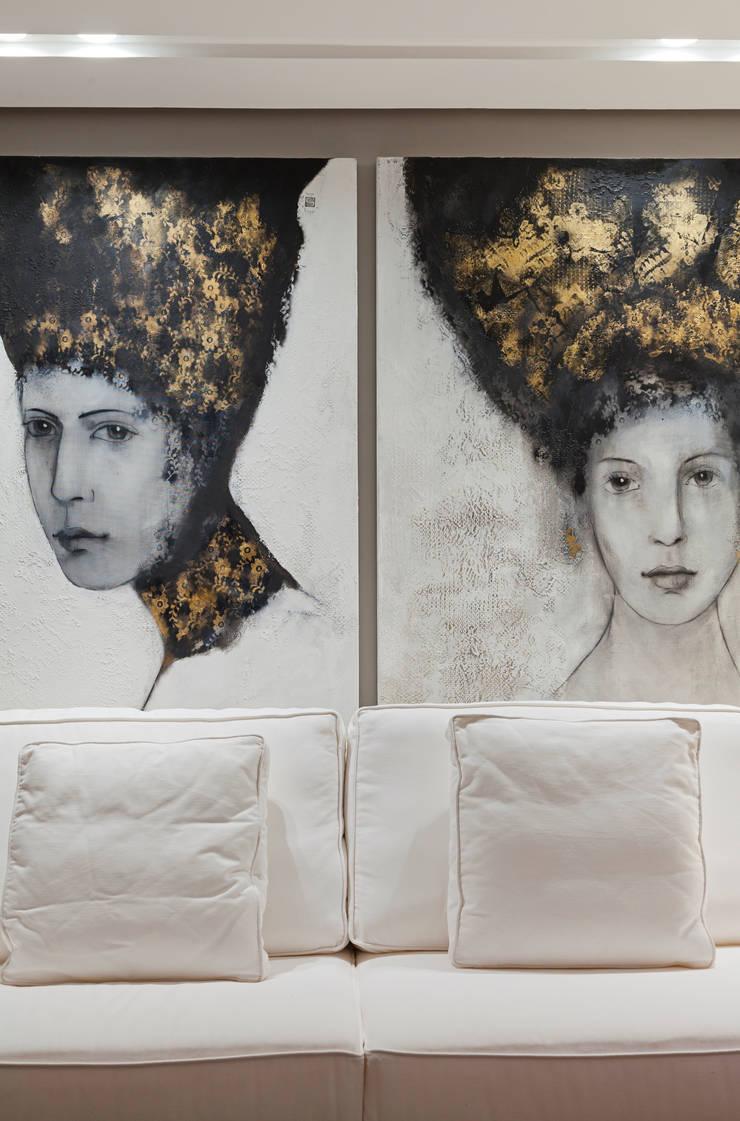 APARTAMENTO PORTO ALEGRE : Salas de estar  por Joana & Manoela Arquitetura
