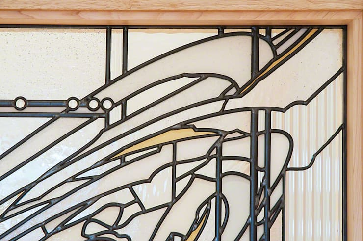 玄関正面手摺 クローズアップ: マルグラスデザインスタジオが手掛けた玄関&廊下&階段です。