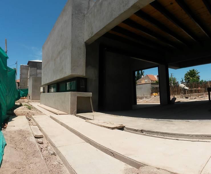obra: Casas de estilo  por modulo cinco arquitectura