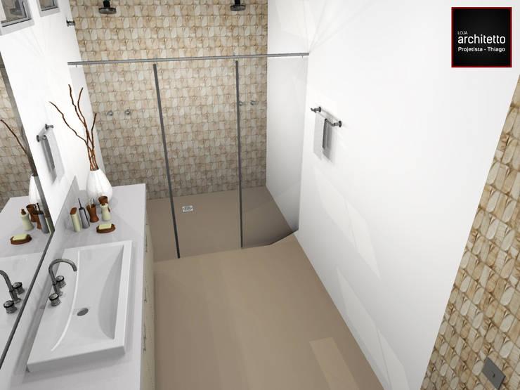 Banheiro Casal luxuoso: Banheiros modernos por Loja Architetto