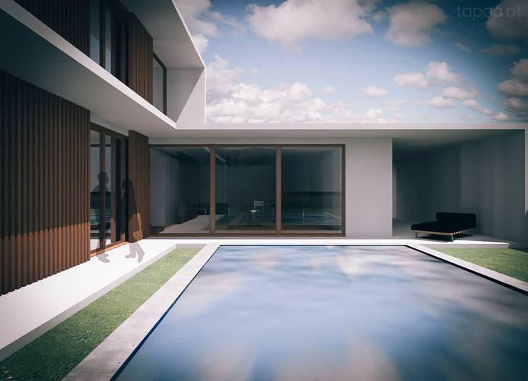Casa na Charneca da Caparica: Casas  por Tapada arquitectos