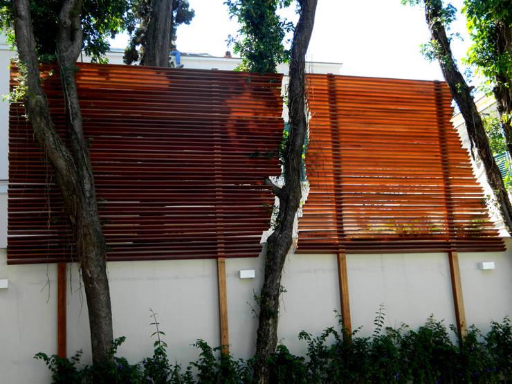 Residência 500m²: Casas  por Fabiana Rosello Arquitetura e Interiores